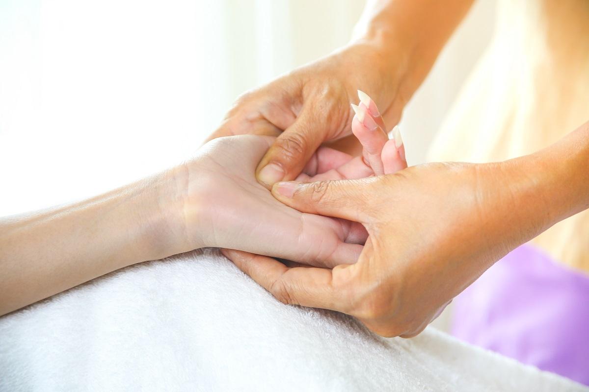 Female hand massage with pressure point massage