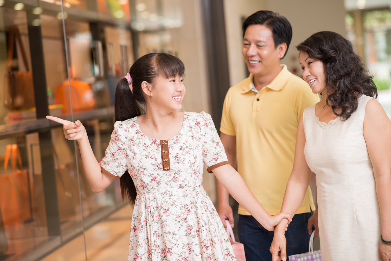 An Asian family at a shopping mall