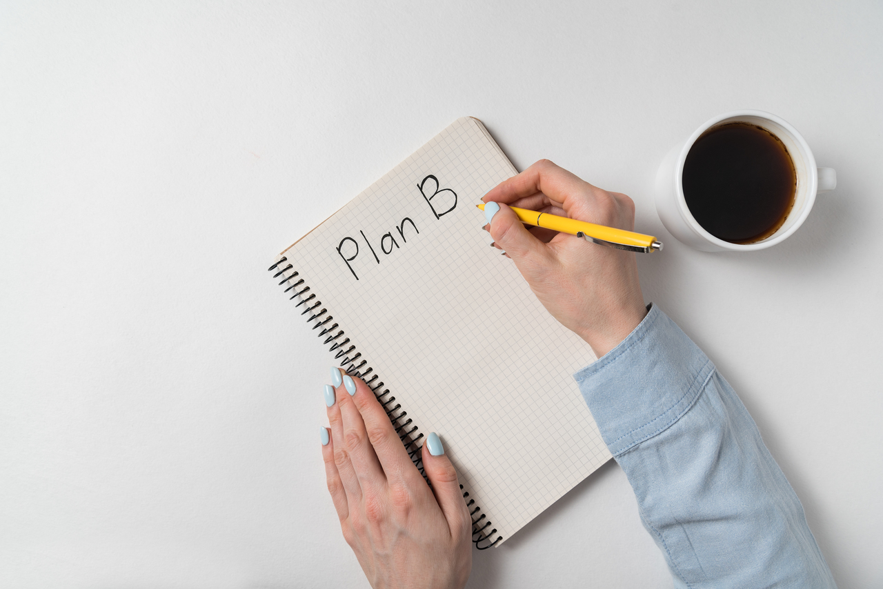 A person writing event contingency plans