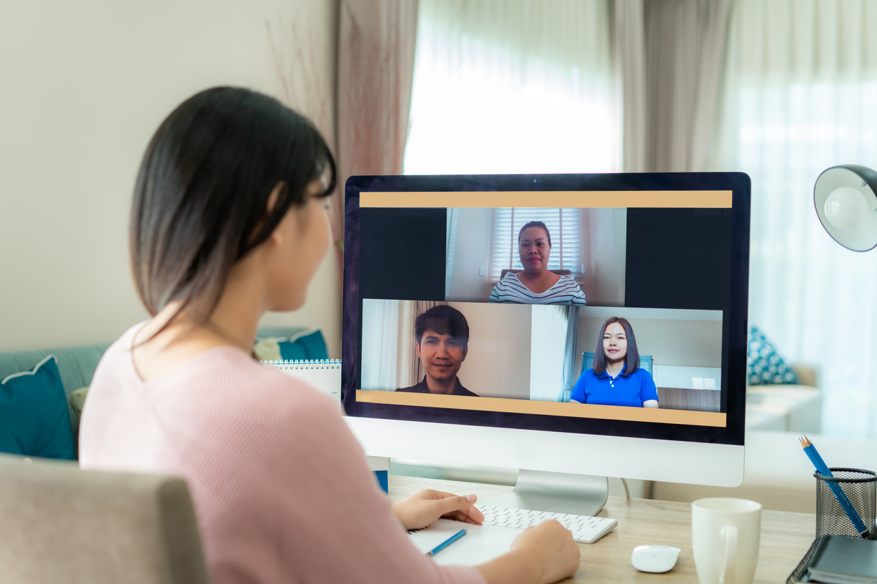 A woman virtual event planning with her team