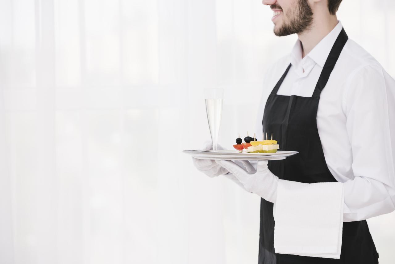 A waiter at a wedding post-COVID-19